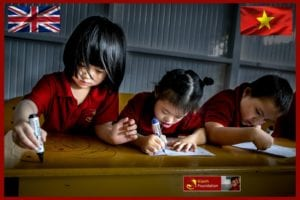 3 young Vietnamese girls studying